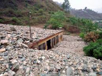 One dead, 3 injured in State landslide